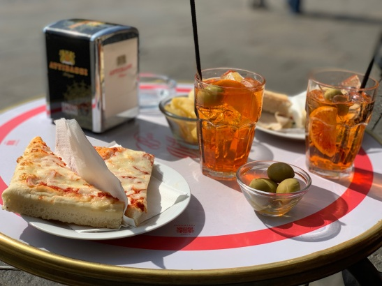 Enjoy a spritz and a sandwich on the square!